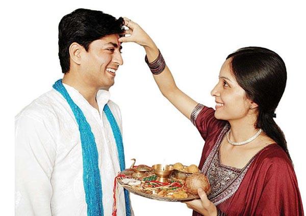 Applying Tilak, Chawal on Forehead