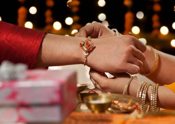Tying Rakhi to the wrist