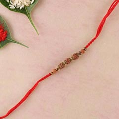 Rudraksha and brass beads rakhi in red spiral woven thread - FOR AUSTRALIA