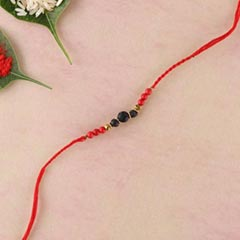 Lava and red stab stone rakhi in twisted red thread