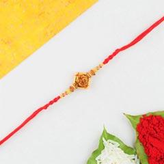 Aum rakhi in red thread