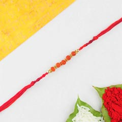 Five rudraksha in red cotton thread rakhi