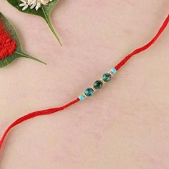 Green agate and stab turquoise beads rakhi in flat woven red thread