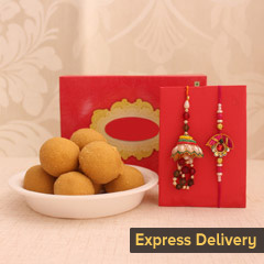 Dazzling Rakhi  with Sweets