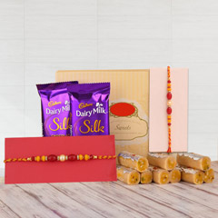 Two Pearl Rakhis with Sweet Delights