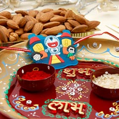 Aum Rakhi Set with Dry Fruit Pooha Thali