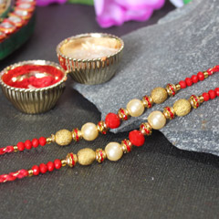 2 Golden and Red Beaded Pearl Rakhis