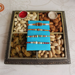 Divine set of Rakhis with sweet dry fruits