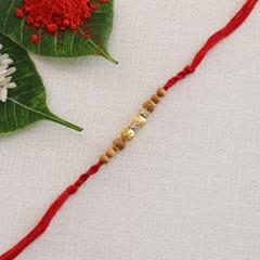 Golden Designer Red Rakhi Thread
