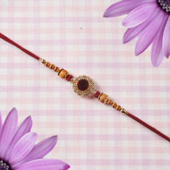Beautifully Crafted Maroon Ruby Rakhi
