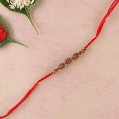 Rudraksha and brass beads rakh..