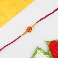 Aum rakhi in red cotton thread