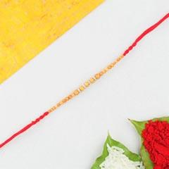 Wooden Beads Rakhi in Red Cott..