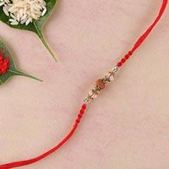 Rudraksha and crystal rakhi wi..