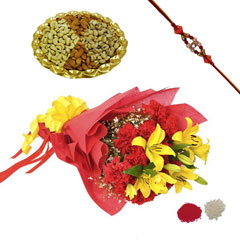 Rakhi with Lilies and carnatio..