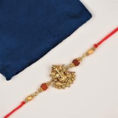 Divine Ganpati Rakhi in Brass ..