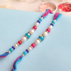 Pretty Beaded White-Blue Rakhi..