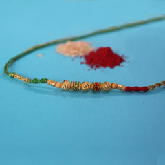 Dazzling Golden Beaded Rakhi