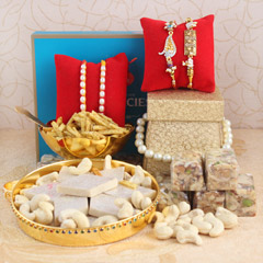 Set of 4 Rakhis with Tasty Del..