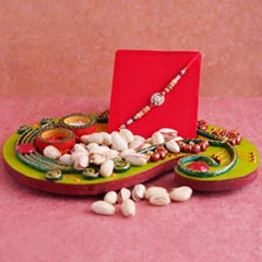 AD Rakhi with Pistachios N Puj..