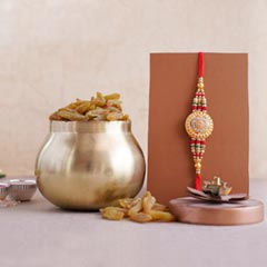 Golden Rakhi with Resins in Co..