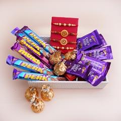 Four Rakhis with Chocolates in..