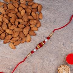 Elegant Pearl Thread Rakhi And..